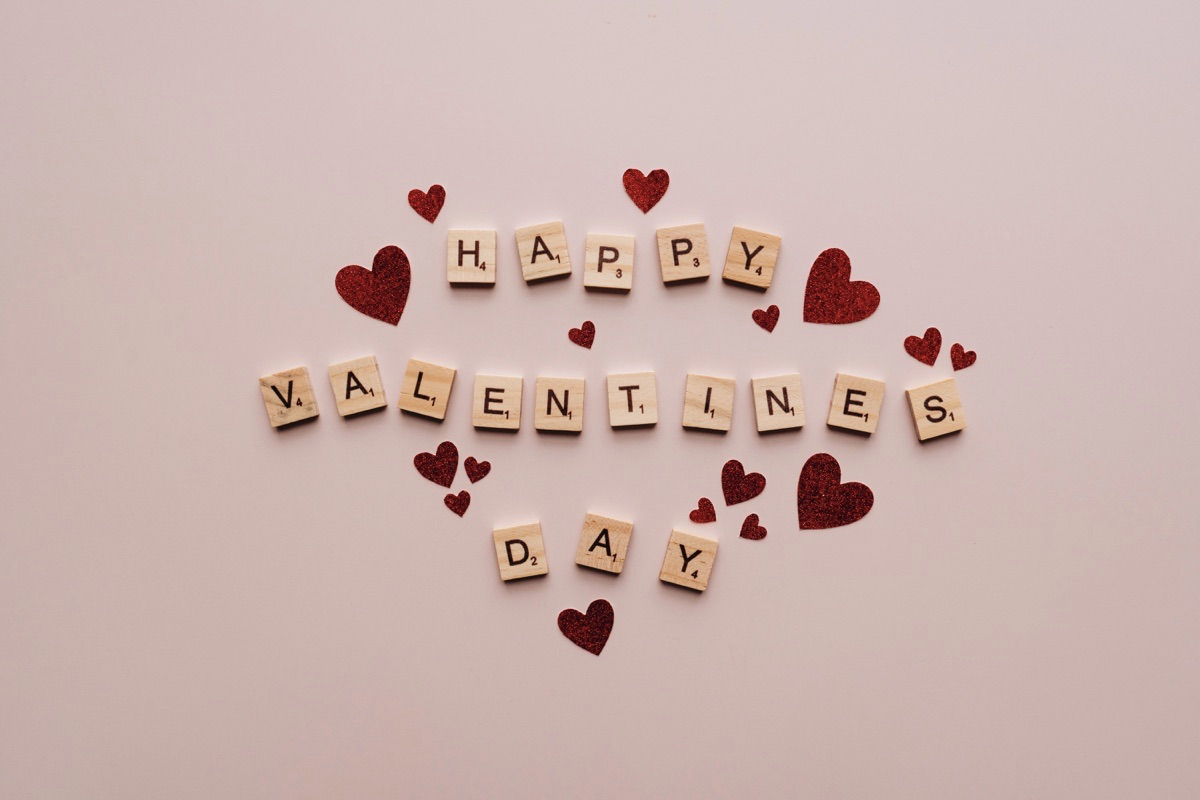 Scrabble tiles spelling out Happy Valentine's Day